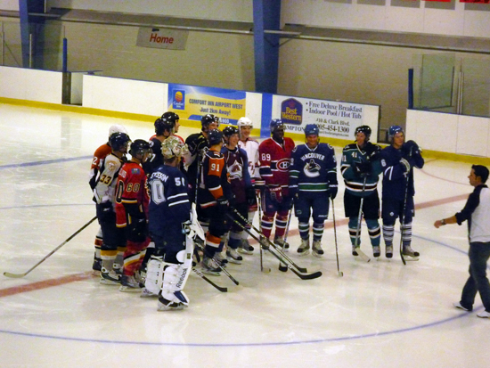 On-Ice Station: All 14 of the participating rookies listen for instruction at Station No. 1.