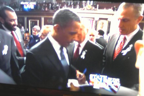 BabrackObama Signs Autographs following his State of the Union Address.