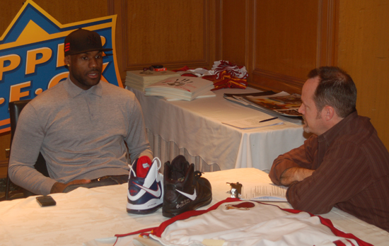 LeBron discusses game-used equipment with UD's Terry Melia.