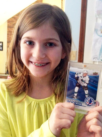 2014-Upper-Deck-National-Hockey-Card-Day-Kids-Happy-Holding-Hertl-Girl