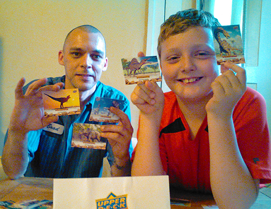 father son collect upper deck dinosaur trading cards together